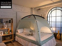 the bed tent ah nature outdoor style tent for your indoor bed geekologie