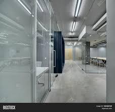 corridor between work zones in the office in a loft style zones