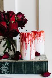 spooky halloween decorating idea how to make bloody candles how