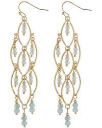 accessorize clip on earrings lyst accessorize disc earrings in blue
