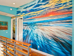 learn how to create and hang a custom wall mural hgtv s blue hall with multicolor ocean mural