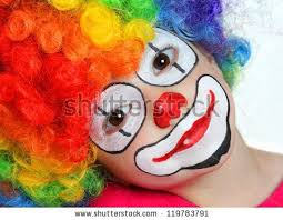 two cheerful clowns birthday children bright stock photo happy clown painting for kids pretty girl with painting