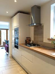 Tiled Kitchen Worktops - howdens white gloss intergrated kitchen with solid oak full stave