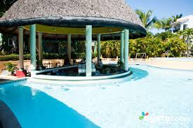 swim up bar at the barcelo capella beach resort near boca chica