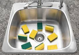 How To Clean The Kitchen Sink Lots Of Yellow Sponges In A Clean Kitchen Sink Stock Image Image