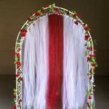 wedding arches decorated with tulle wedding arch is decorated with white tulle twinkle lights and