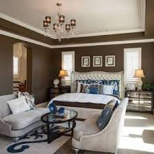 master bedroom layout with sitting area and brown walls with white