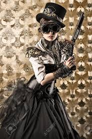 victorian halloween background portrait of a beautiful steampunk woman holding a gun over vintage