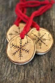 wood burned tree ornaments snowflakes