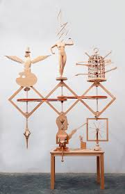 kinetic wood sculptures by john buck