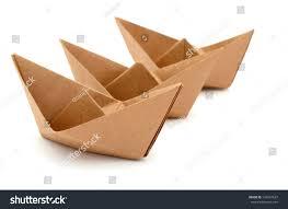 Cardboard Origami - three origami boats on sailing concept stock photo 125647637