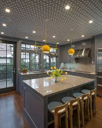 gray island cabinets and backsplash yellow pendant lights wooden