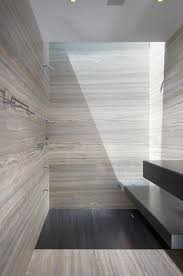 20 pictures and ideas of travertine tile designs for bathrooms sophisticated bathroom with grey travertine walls the liane lane