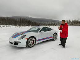 porsche 911 snow smashing through the snow at porsche u0027s camp4 with digipower u0027s re