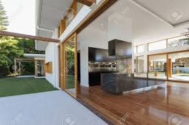 luxurious kitchen and living room in new mansion stock photo