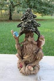 tree sitting figurine with owl on arm yard ornament statue