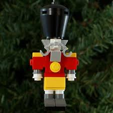 trimming the tree with awesome lego ornaments