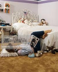 bedroom magazine 1980s teenage girl lying on bedroom floor reading magazine talking