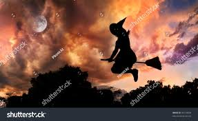 halloween witch silhouette glowing eyes flying stock photo