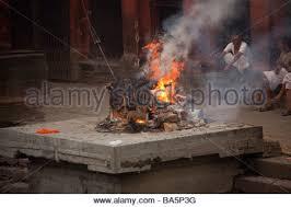 human cremation human being burnt on cremation ghats bagmati riverbank at