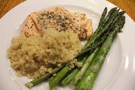 simple quinoa recipe served with salmon and asparagus hip foodie