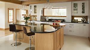 Curved Floor L L Shaped Brown Wooden Kitchen Island With Black Countertop