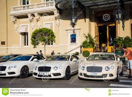 white bentley cars three white bentley cars parked in front of monte carlo casino