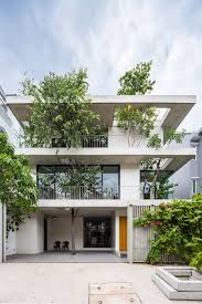 col house tree branches poke through floors of stacked planters house