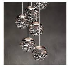 italia design galvanized tolix chairs and globe pendants dining rooms