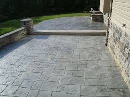 Sub Base For Patio by Minimalist Details On Stamped Concrete Patio Near Retaining Wall