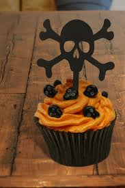 halloween themed cake toppers halloween cupcake toppers skull and crossbones cupcake toppers