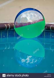 inflatable ball in a backyard pool stock photo royalty free image