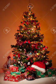beautiful christmas tree with gifts flower and lights glowing