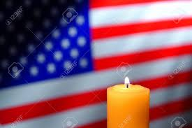 Burning Red Flag Commemorative Prayer Candle Burning With A Soft Glowing Flame