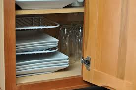 adding a decorative touch to the cabinets with duck brand u0027s shelf
