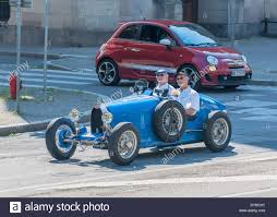 convertible bugatti 2 elderly men driving a blue convertible bugatti french vintage