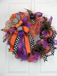 dotted ribbons gerber daisies and mini black pumpkins are fun