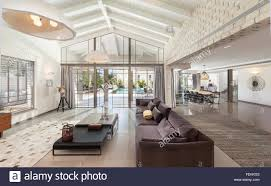 a large dining room in an open plan villa a long table and chairs