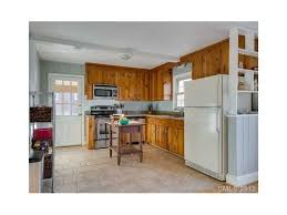 best way to paint pine kitchen cabinets knotty pine cabinet help