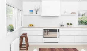 white kitchen interior with white modular circular kitchen center