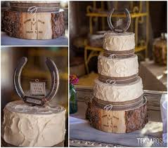 country style wedding cake with horse shoe topper and wood block