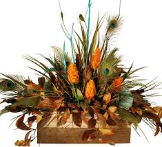 floral arrangement using turquoise and peacock feathers in wooden