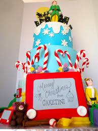 elf movie christmas cake with buddy the elf figurine byrdie