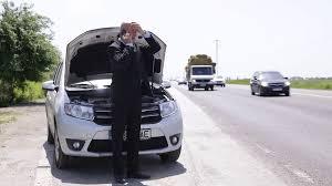 car service driver businessman driver nervous have technical car problem use phone