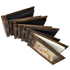 wooden photo album two large wedding rings on a wooden album and guestbook as a symbol o
