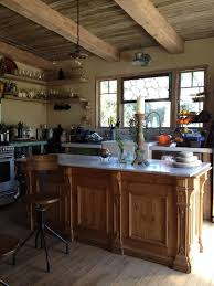 rustic kitchen with pendant light u0026 farmhouse sink zillow digs