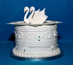royal icing cake with a collar and swans made during the course