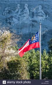 State Flag Of Georgia The Georgia State Flag Waving In The Wind Beneath The Confederate