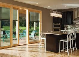 exterior design black wooden pella doors with silver handle for slider pella doors on tan wall matched with wooden floor plus dining table sets for dining
