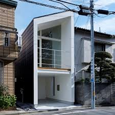 tiny japanese apartment house by another apartment